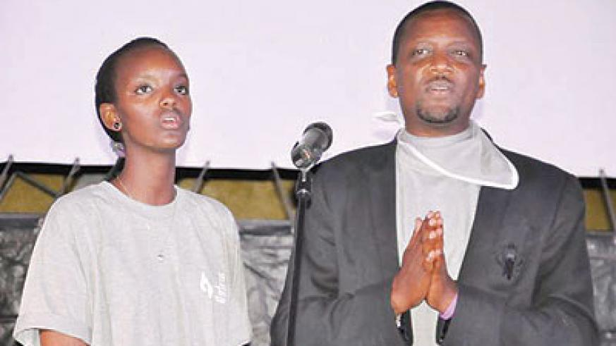 Miss Rwanda Aurore Mutesi and singer  Intore Masamba at the commemoration event. The New Times / File.