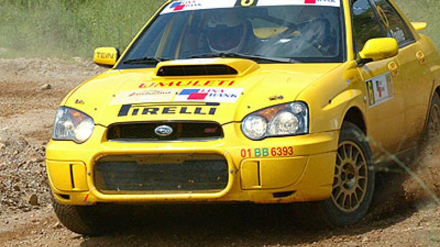 Davite Giancarlo and  Slyvia Vindevogel cruising their Subaru Imprezza in past rally. The duo, in their new Mistubishi Evo 10 are already in South Africa. The New Times / File.