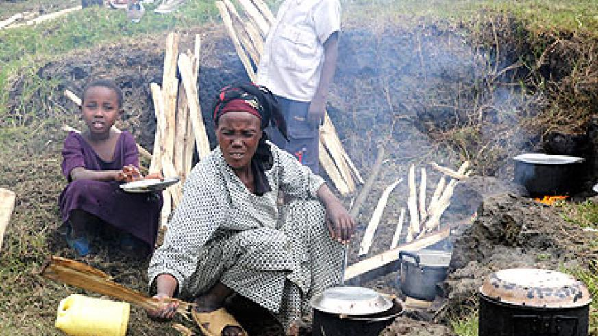 A refugee prepares a meal at Nkamira transit centre last year.  The New Times/ File.