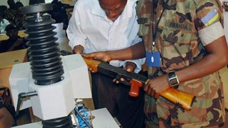 Officials mark firearms in Kigali on Monday.  The New Times/ John Mbanda.