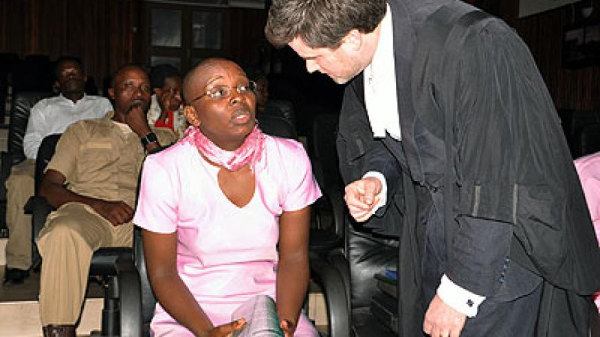 Ingabire (L) consults with her lawyer Edwards during the appeal hearing.  The New Times/ J. Mbanda.