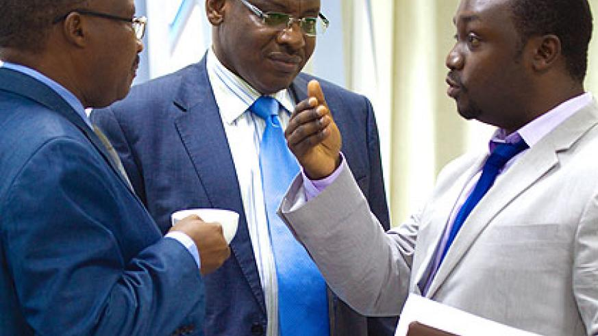 L-R: Cabinet Affairs minister Protais Musoni, Finance Minister Gatete and State minister Evode Imena (Mining) chat at the Finance Ministry headquarters in Kigali yesterday.  The New Ti....