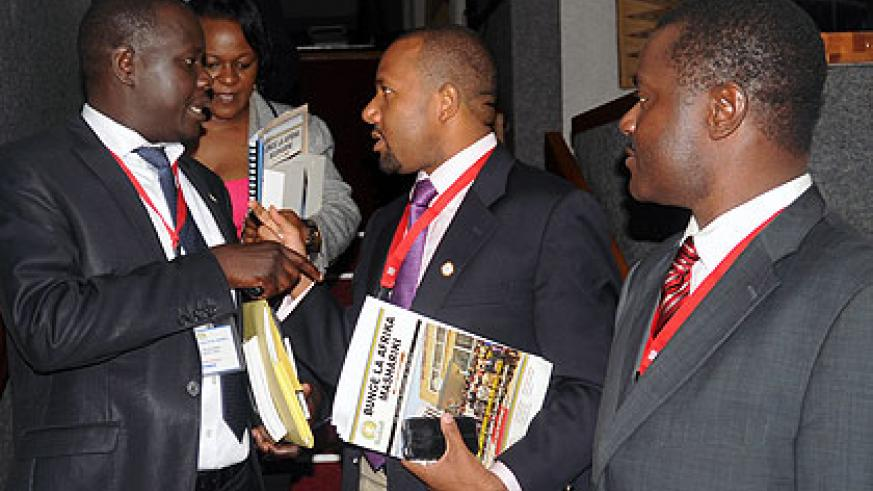 EALA members chat at the end of yesterday's business. The New Times/John Mbanda.