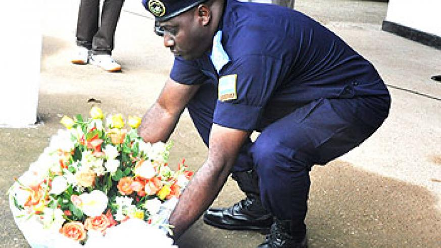 Gasana lays a wreath at Kamonyi Memorial site during when his Force paid tributes yesterday. The New Times/ Courtesy.