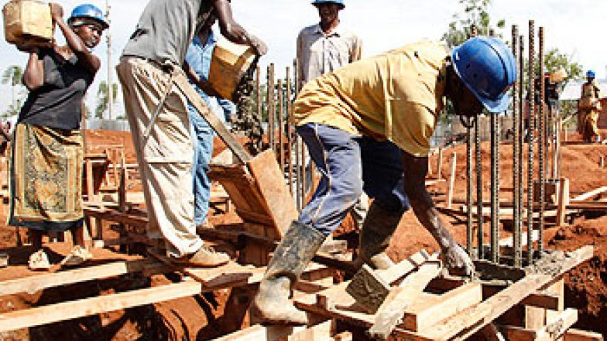 Masons working on a construction site. Infrastructure minister Lwakabamba has said the engineers regulator should enforce standards. The New Times/File.