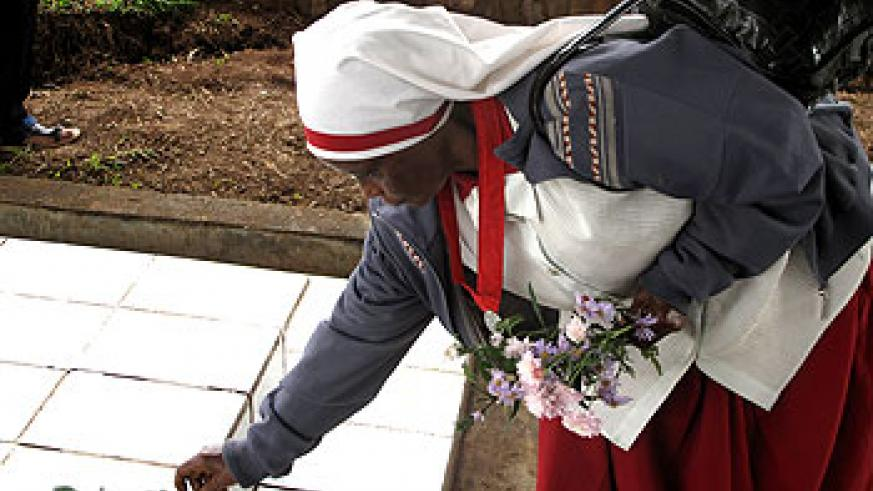 A nun pays her respects to Genocide victims in Munyaga. The New Times/S. Rwemebeho.