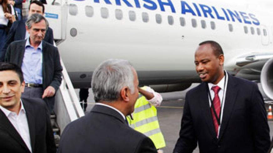 Albert Nsengiyumva (R), then Minister of infrastructure welcomes Turkish airlines officials upon the maiden landing of the aircraft at Kigali International Airport last year. The New T....