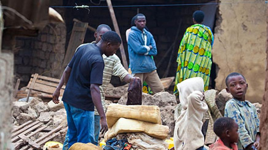 A family, whose house was destroyed by rain in Gatsata sector recently, tries to salvage some property from the rubble.   The New Times/T. Kisambira.