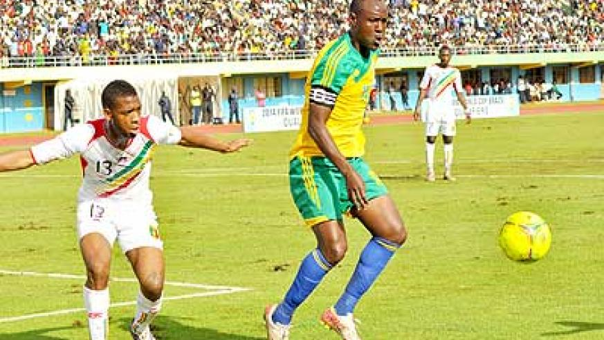 Amavubi skipper Olivier Karekezi (R) during a past match at Amahoro Stadium. He and his teamates have failed to deliver, leading to coach Micho's sacking .  The New Times /file.