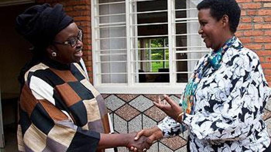 Gender and Family Promotion minister Oda Gasinzigwa (R) chatting with Bineta Diop Founder and president of Femmes Africa Solidarité. The New Times/T.Kisambira.