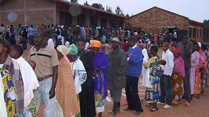 Eligible voters line up to cast their votes in a previous election. This years parliamentary polls are set for September.   The New Times/ File.