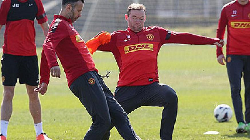 Wayne Rooney flies into a tackle on Ryan Giggs in Manchester United's training ahead of Monday's game against Villa. Net photo.