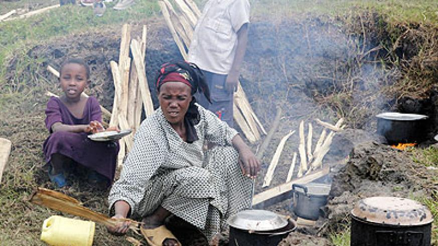 A refugee from Congo prepares a meal at Nkamira transit centre in Gisenyi. The New Times /T. Kisambira.