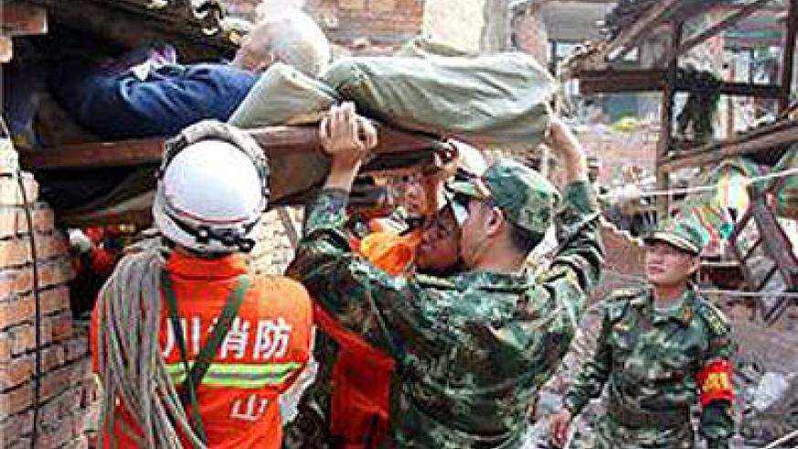 More than 90 people have been pulled alive from rubble as more than 17,000 rescuers help out. Net photo.