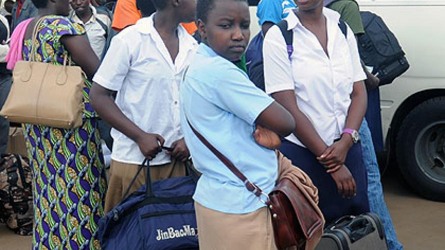 STRANDED: Students wait for transport to school at Nyabugogo Bus Terminal yesterday. Education officials say about 90 per cent of the student population returned to school as the secon....