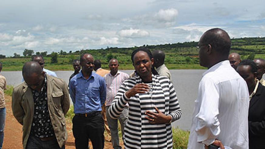 Dr Kalibata (L) talks to officials and rice farmers in Nyagatare recently. The minister told the farmers that with improved farming methods, they can hit Rwf3.5 billion annually.  The New Times/ T. Ishimwe