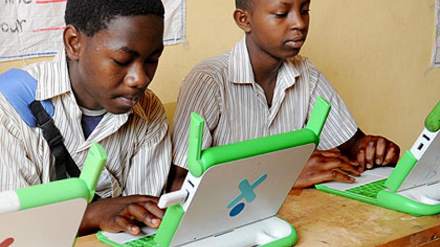 Pupils in Kigali busy with their OLPC laptops. The New Times/ File.