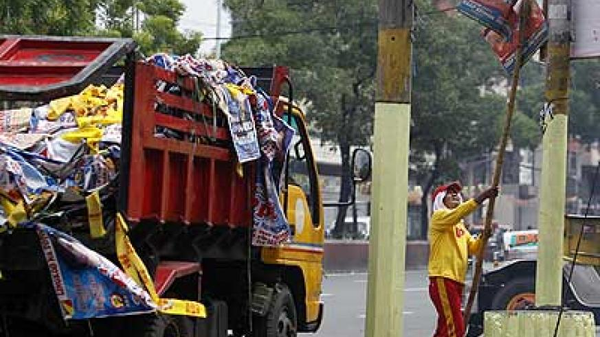 Cleanup starts a day after the May 13 midterm elections, which saw the ruling coalition win solid majority. Net photo.