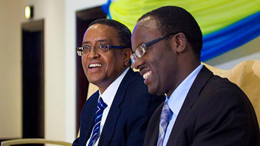 City of Kigali mayor Ndayisaba (R), and the  Minister of Infrastructure, Prof Lwakabamba during the launch of the  online Construction Permit Management Information System, yesterday. The New Times/Timothy Kisambira.