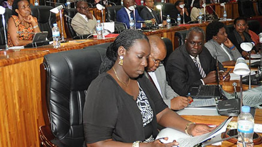 Parliamentarian deliberate during a past session.   The New Times/ File.