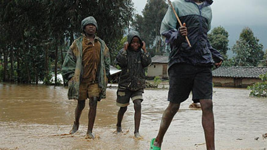 Children play after heavy rains. Over 80,000 households have been earmarked for evacuation countrywide according to officials.  New Times/File.