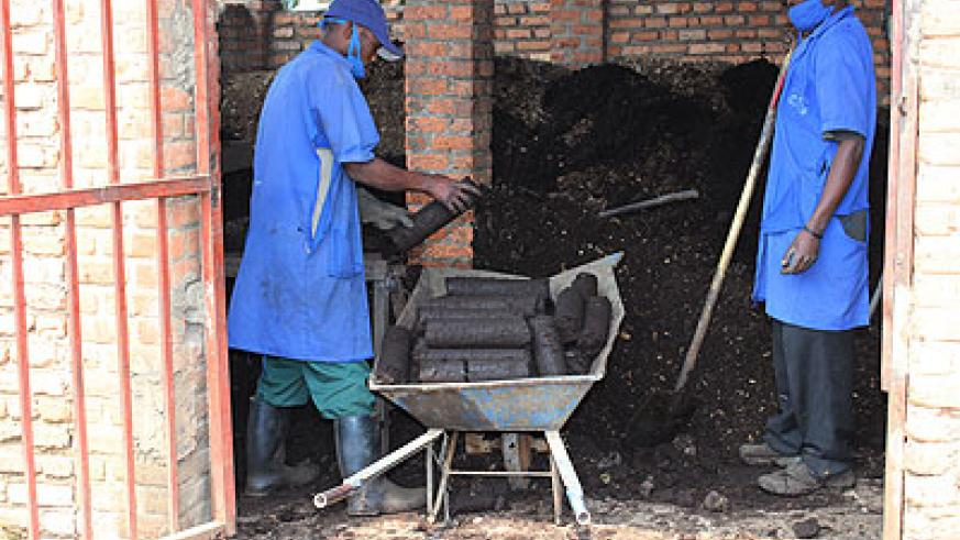 Workers make Briquettes out of waste. Guyana intends to learn from Rwanda about waste managenent. Courtesy photo.