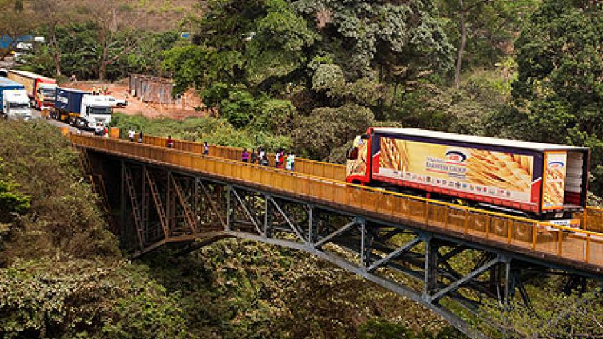 Trucks in transit cross a bridge in Rusumo. Amb. Kayonga has said the single customs treaty will not affect traders. The New Times/ Timothy Kisambira.