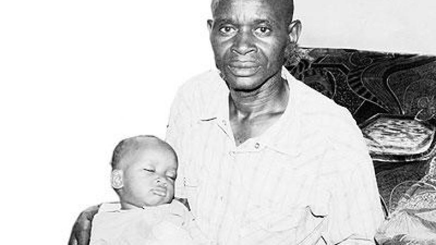 "Mzee Antoine Bizimana with one of his ""children"". Sunday Times/Joseph Oindo"