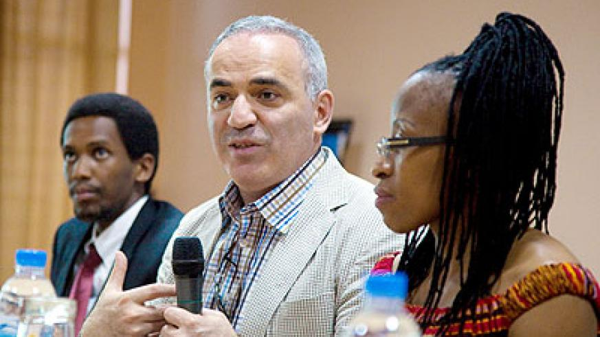 Chess legend Kasparov (C) addressing journalists in Kigali yesterday. Looking on are Kevin Ganza, vice chairman, Rwanda Chess Federation (L), and Africa Msimang (R), a member of Garry ....