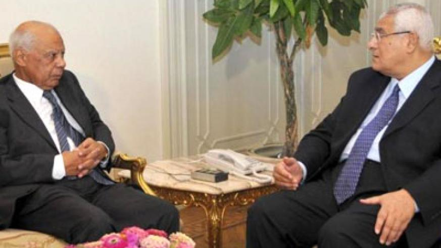 Beblawi, left, an ex-finance minister, was named the new prime minister by interim leader Mansour, right. Net photo.