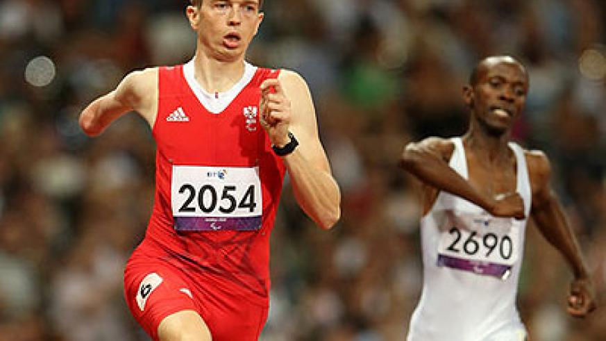 Muvunyi (R) and Matzinger of Austria competing in the London Olympic Games last year. Net photo.