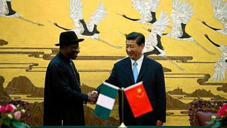 Goodluck Jonathan and his Chinese counterpart Xi sign accords for loans to develop West African nation's infrastructure. Net photo.