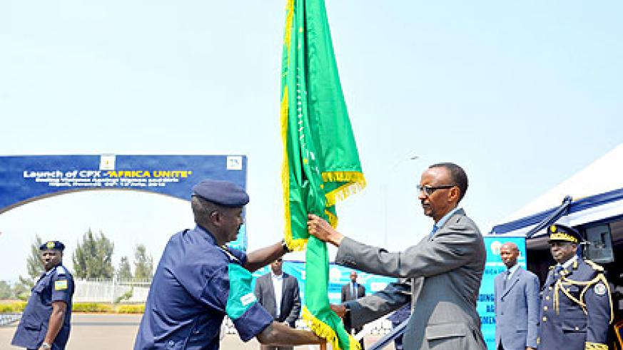 President Kagame receives the African Union flag, shortly before flagging off the 'Africa UNITE' Command Post Exercise, at the Rwanda National Police Headquarters in Kigali yesterd....