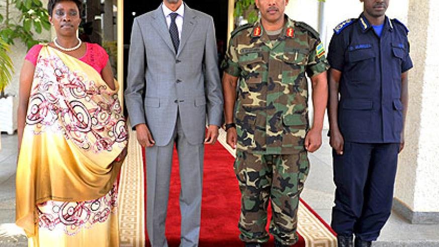 <p>President Kagame together with the new minister for EAC affairs, Jacqueline Muhongayire (L)  Chief of Defence Staff, Gen. Patrick Nyamvumba and Dan Munyuza, the Deputy Inspector Gen....