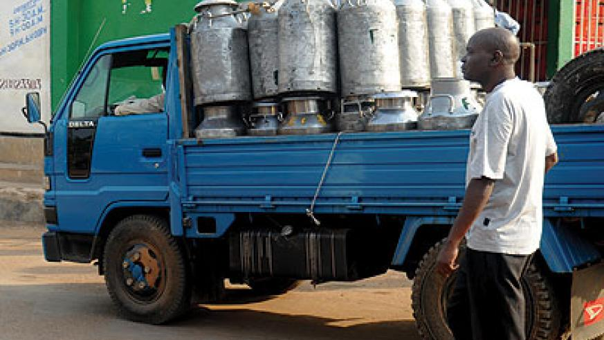 A dealer delivers milk in Kigali. Many traders do not know how some of the business-related laws affect or ease their operations.  The New Times / File photo