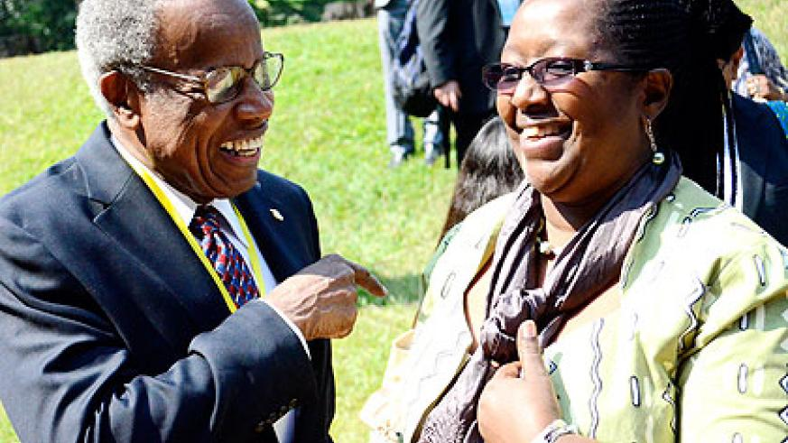 <p>Dr Agnes Binagwaho (R), the minister for health, shares a light moment with Sir George Alleyne, the director emeritus of Pan-American Health Organisation, on the sideline of the con....