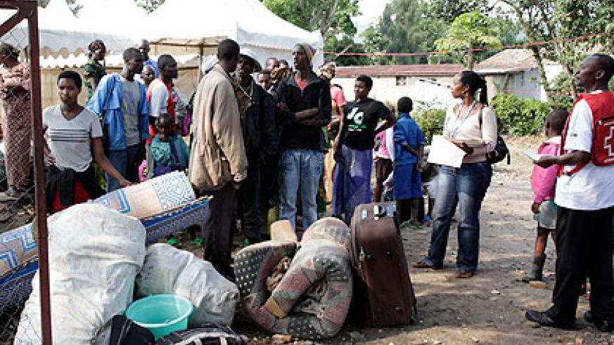 Conglese refugees at Goma-Rubavu border wait to board a Red Cross vehicle. The New Times/ Timothy Kisambira.