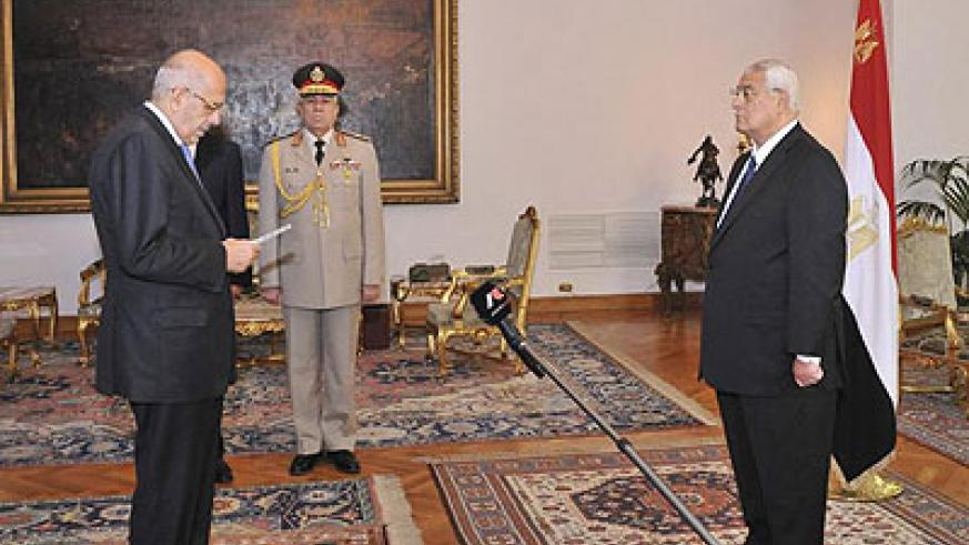 Mohamed ElBaradei, left, is sworn in as interim vice president of Egypt for foreign affairs in Cairo. Net photo.