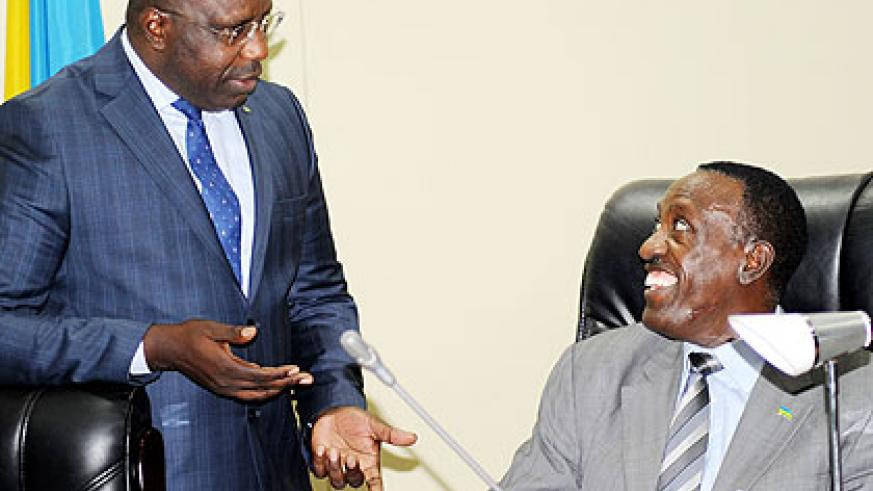 Prime Minister Pierre Damien Habumuremyi (L) chats with Senate President Jean Damascene Ntawukuliryayo at Parliament yesterday. Lawmakers commended the government on achievements in th....