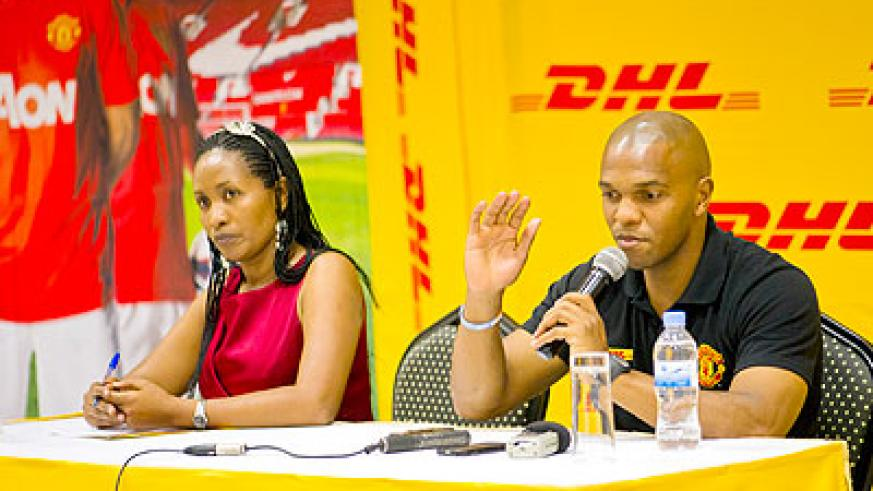 DHL Country Manager Julie Mutoni and Manchester United African ambassador Quinton Fortune. The New Times/Courtesy