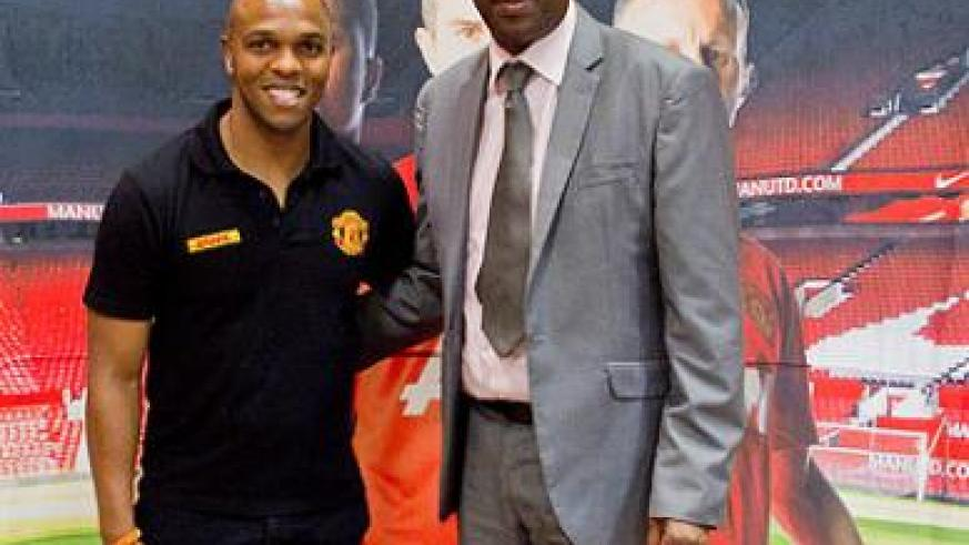 Minister Protais Mitali with Quinton Fortune. Mitali  has lauded  DHL Express for inspiring young Rwandan footballers. DHL is the official Logistics Partner of Manchester United. The N....