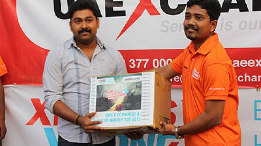 Suveesh Kottemal receiving playing T-shirts from UAE EXCHANGE Rwanda boss N. Riyaz at the inaugural ceremony.