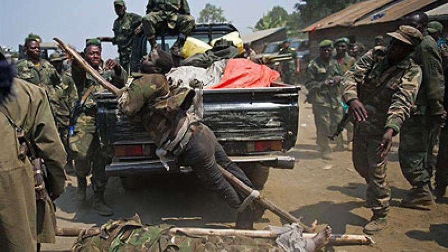 FARDC desecrating the bodies of the enemy. This is the same barbaric army that Monusco is helping. Net photo.