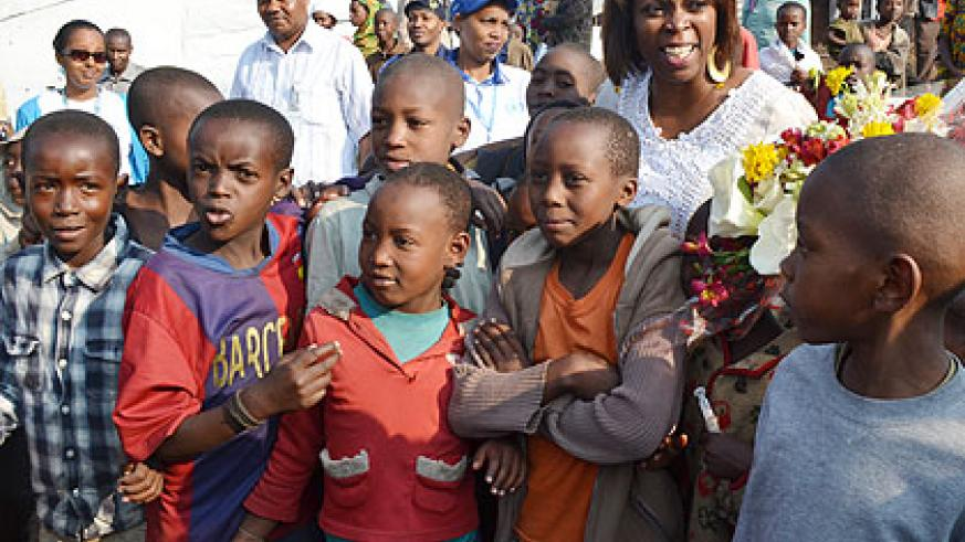 The UN Under-Secretary General and Executive Director of the World Food Programme Cousin, with some of the children at Nkamira Transit Centre. The New Times/ Jean d'Amour Mbonyinshuti