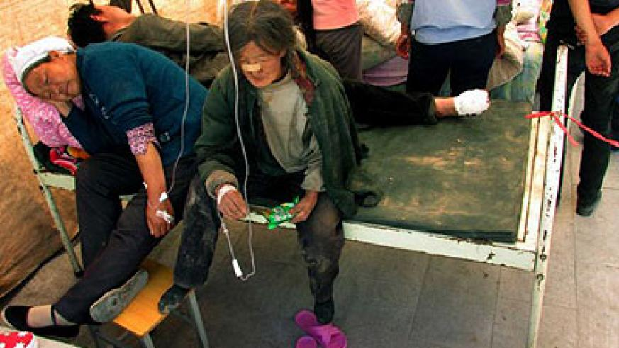Victims of an earthquake receive treatment in a makeshift tent at a hospital in Minxian County, northwest China's Gansu Province, July 22, 2013.  (Xinhua/Han Congzhi)