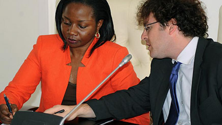 <p>The State Minister for Energy and Water, Emma Fran&ccedil;oise  Isumbingabo (L,  signs a $23 million ( Rwf15 billion) energy agreement with Gigawatt Global&rsquo;s Vice President Ch....