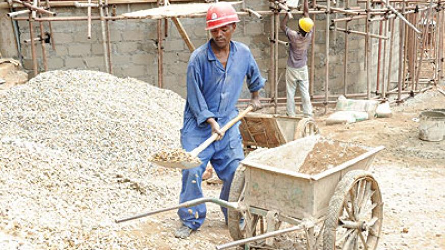 Workers at a building site. Checking the quality of materials promotes safety. The New Times / File
