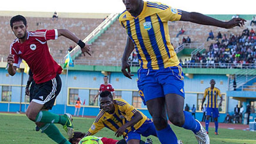 Striker Jessy Reindorf  (R) in action for Amavubi during a friendly match against Libya in March. The New Times/T. Kisambira.