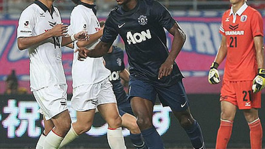 Wilfried Zaha celebrates his last-minute equaliser for Manchester United. Net photo.