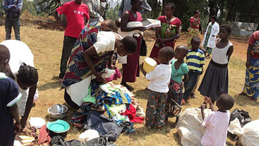 Some of the returnees from DR Congo shortly after their arrival on Friday.   The New Times/ Vedaste Ngabo.